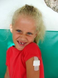 girl-with-plaster-and-missing-tooth-1-630428-m